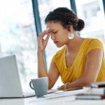 A woman experiencing eyestrain